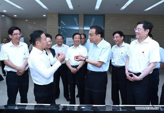 Chinese Premier Li Keqiang visits Hengyang Baishazhou Industrial Park in Hengyang, central China's Hunan Province, June 11, 2018. The visit is part of his two-day inspection trip to the cities of Hengyang and Changsha, which ended Tuesday. (Xinhua/Rao Aimin)