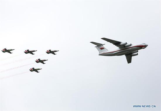 Aircrafts fly over the sky during a military parade marking the Independence Day in Minsk, Belarus, July 3, 2018. (Xinhua/Wei Zhongjie)