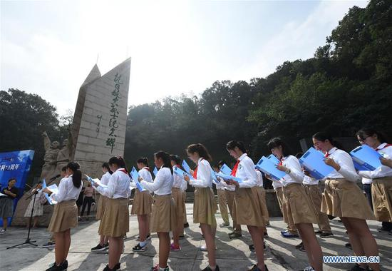 Students recite poems during an activity to commemorate the 73rd anniversary of the victory in the Chinese People's War of Resistance Against Japanese Aggression at Nanjing Anti-Japanese Aviation Martyr Memorial Hall in Nanjing, east China's Jiangsu Province, Sept. 3, 2018. (Xinhua/Sun Can)