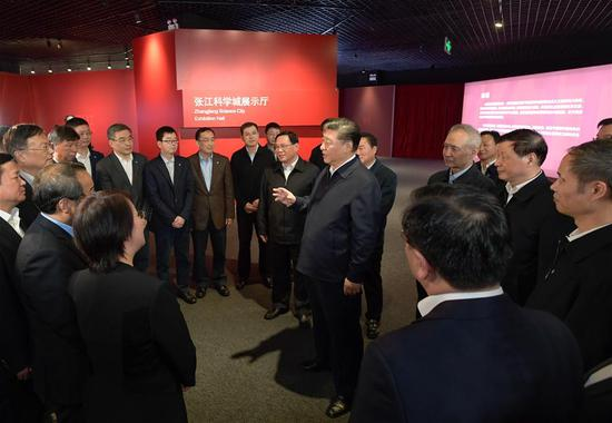 Chinese President Xi Jinping, also general secretary of the Communist Party of China Central Committee and chairman of the Central Military Commission, talks with scientific researchers while visiting an exhibition hall of the Zhangjiang science city in east China's Shanghai, Nov. 6, 2018. Xi Jinping made a two-day inspection in Shanghai, which ended on Wednesday. (Xinhua/Li Xueren)