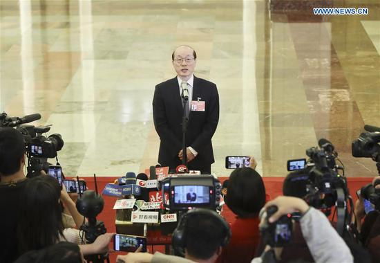 Liu Jieyi, head of the Taiwan Affairs Office of the State Council, receives an interview after the opening meeting of the second session of the 13th National People's Congress at the Great Hall of the People in Beijing, capital of China, March 5, 2019. (Xinhua/Yin Gang)