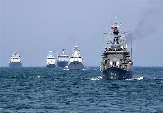 Naval vessels take part in a joint naval exercise on the sea off Qingdao, east China's Shandong Province, on April 26, 2019.