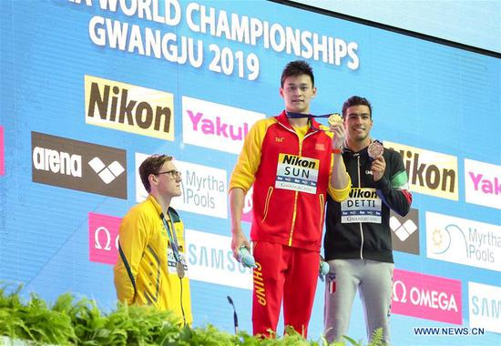 Sun Yang (C) of China, Mack Horton (L) of Australia and Gabriele Detti of Italy pose during the medal ceremony for the men's 400m freestyle final at the Gwangju 2019 FINA World Championships in Gwangju, South Korea, July 21, 2019. (Xinhua/Bai Xuefei)
