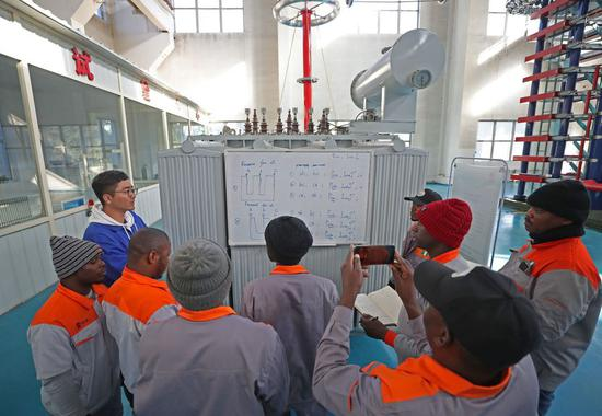 Nigerian engineers study during a training session in a factory of Huaye Group in the city of Anshan, northeast China's Liaoning Province, Oct. 14, 2019. (Xinhua/Yang Qing)