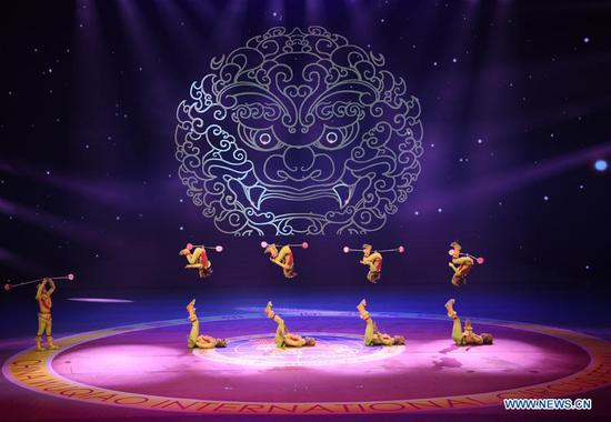 Chinese acrobats perform during the 17th China Wuqiao International Circus Festival in Cangzhou, north China's Hebei Peovince, Nov. 7, 2019. The 17th China Wuqiao International Circus Festival concluded here on Thursday. Founded in 1987, the biennial festival is regarded as China's longest-running international circus festival, while boasting a wide influence in the field of acrobatics. (Xinhua/Mu Yu)