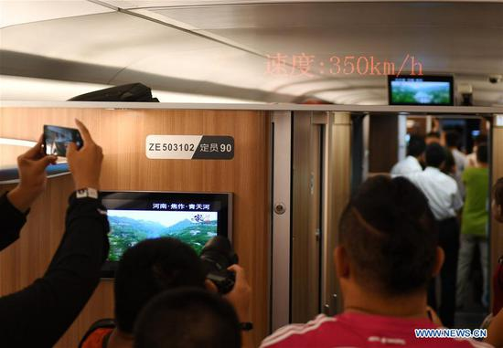 Passengers record the speed of Fuxing bullet train running on the Beijing-Tianjin intercity rail, China, Aug 8, 2018. The speed of Fuxing bullet trains running on the Beijing-Tianjin intercity rail increased to 350 km per hour Wednesday, cutting the journey to 30 minutes. (Xinhua/Zhang Chenlin)