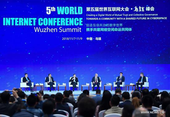 Guests attend the plenary session of the fifth World Internet Conference in Wuzhen, east China's Zhejiang Province, Nov. 7, 2018. (Xinhua/Chen Yehua)