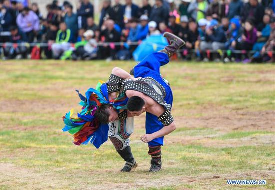 Competitors wrestle at the Genghis Khan Chagan Suluk Nadam Fair in Ejin Horo Banner of Ordos City, north China's Inner Mongolia Autonomous Region, April 24, 2019. The two-day fair kicked off on Wednesday, including a variety of traditional activities. (Xinhua/Peng Yuan)