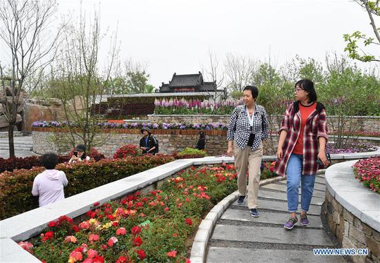 Visitors tour the Shanxi Garden at the Beijing International Horticultural Exhibition in Yanqing District of Beijing, capital of China, May 12, 2019. The