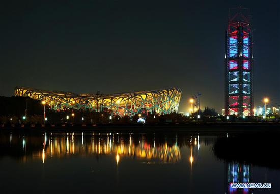 Photo taken on May 14, 2019 shows the night view of the National Stadium, also known as the Bird's Nest, and the Linglong Tower in Beijing, capital of China. Roads and buildings were illuminated Tuesday evening before the upcoming Conference on Dialogue of Asian Civilizations (CDAC) in Beijing. (Xinhua/Chen Jianli)