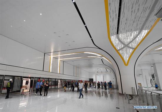 Photo taken on June 15, 2019 shows a station of a new airport subway line at Beijing Daxing International Airport in Beijing, capital of China. Self-driving trains for the subway line connecting downtown Beijing with its new international airport started trial run Saturday, according to local authorities. Stretching 41.4 kilometers, the new line supports autopilot system and can run at a speed of 160 km per hour, with as many as 448 passengers, according to Beijing Major Projects Construction Headquarters Office. (Xinhua/Zhang Chenlin)