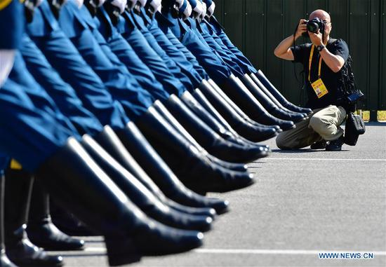 A journalist takes photos during a visit to the National Day military parade training site in Beijing, capital of China, Sept. 25, 2019. A total of 47 journalists from home and abroad on Wednesday visited a training site of the military parade for the upcoming National Day celebrations. (Xinhua/Wei Peiquan)