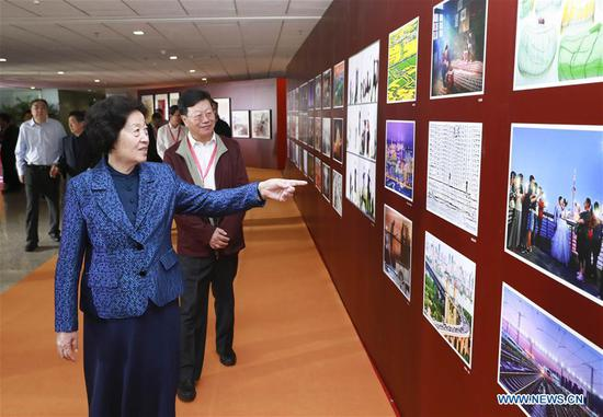 Chinese Vice Premier Sun Chunlan visits a photo exhibition during an awareness event to respect the elderly on Oct. 8, 2019, one day after the Chongyang Festival, equivalent to China's Seniors' Day. (Xinhua/Pang Xinglei)