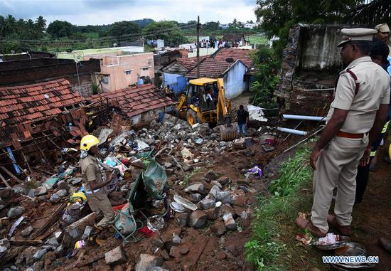 Rescuers inspect the debris of collapsed houses at Nadur village in Coimbatore district, some 500 km southwest of Chennai, the capital city of Tamil Nadu, India, on Dec. 2, 2019. With the recovery of two more bodies from the debris of collapsed houses, the death toll in the southern Indian state of Tamil Nadu rose to 17 on Monday, officials said. (Str/Xinhua)