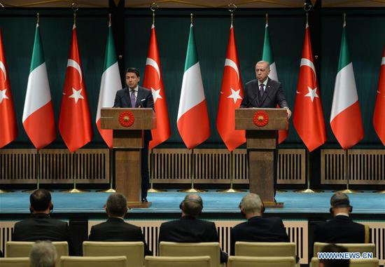 "Turkish President Recep Tayyip Erdogan (R) and Italian Prime Minister Giuseppe Conte attend a joint press conference in Ankara, Turkey, on Jan. 13, 2020. Negotiations between Libya's warring leaders in Moscow are going positively, Recep Tayyip Erdogan said Monday. ""We are trying to make the cease-fire in Libya permanent,"" Erdogan said at a press conference in Ankara with visiting Italian Prime Minister Giuseppe Conte. (Photo by Mustafa Kaya/Xinhua)"