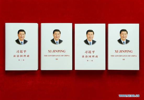 "Photo taken on June 29, 2020 shows the third volume of ""Xi Jinping: The Governance of China"" in both Chinese and English. The third volume of ""Xi Jinping: The Governance of China"" has been published by the Foreign Languages Press in both Chinese and English and will be available at home and abroad. (Xinhua/Li He)"