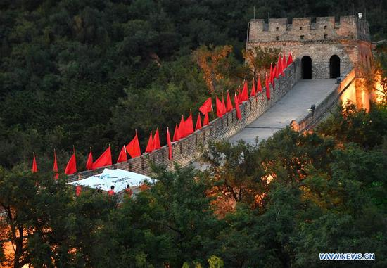 The flag of Beijing 2022 Winter Olympic Games is seen on the Great Wall during cultural activities to welcome the Beijing 2022 Olympic Winter Games' 500-day countdown in Badaling, Yanqing District of Beijing, capital of China, Sept. 20, 2020. (Xinhua/Zhang Chenlin)