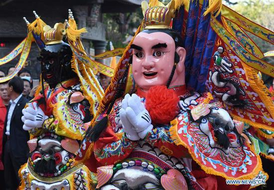 A statue of the Chinese sea goddess Mazu is lifted for a parade around the Meizhou Island in Putian City, southeast China's Fujian Province, Oct. 25, 2020. In 2009, the Mazu belief and customs were inscribed on the UNESCO Representative List of the Intangible Cultural Heritage of Humanity. (Xinhua/Wei Peiquan)