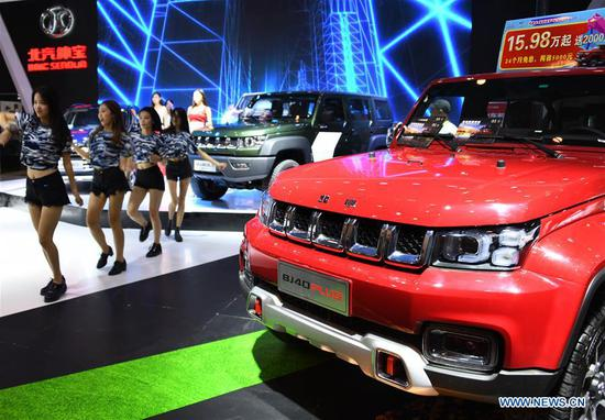 Photo taken on Sept. 13, 2018 shows a BJ40 Plus car during the Auto Qingdao Autumn 2018 in Qingdao, east China's Shandong Province. Over 600 exhibitors participated in the six-day auto show. (Xinhua/Li Ziheng)