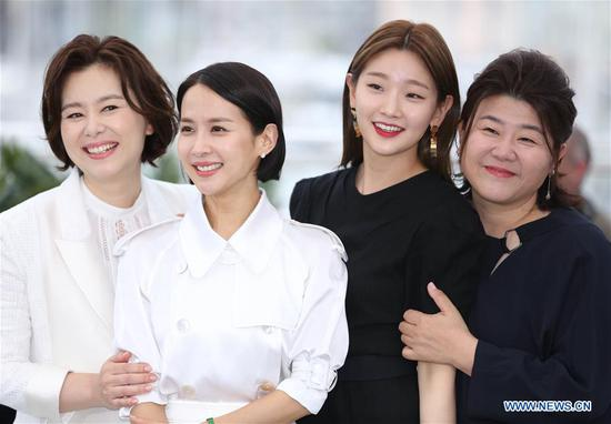 Actresses Cho Yeo-jeong (2nd L) and Park So-dam (2nd R) pose during a photocall for