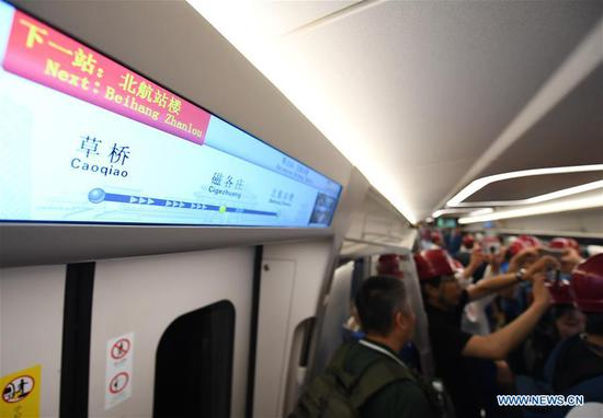 Photo taken on June 15, 2019 shows the inside view of a new airport subway train in Beijing, capital of China. Self-driving trains for the subway line connecting downtown Beijing with its new international airport started trial run Saturday, according to local authorities. Stretching 41.4 kilometers, the new line supports autopilot system and can run at a speed of 160 km per hour, with as many as 448 passengers, according to Beijing Major Projects Construction Headquarters Office. (Xinhua/Zhang Chenlin)
