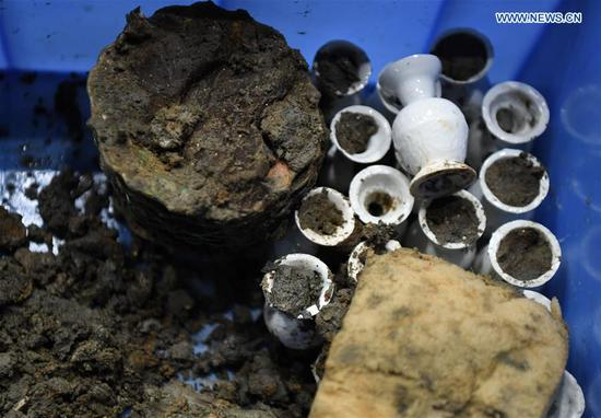 Photo taken on May 12, 2020 shows porcelain products found on the shipwreck of Nanhai No. 1 in Yangjiang, south China's Guangdong Province. The excavation of the Nanhai No. 1, a shipwreck dating back to the Song Dynasty (960 A.D.-1279 A.D.), has entered the final stage and is expected to conclude in 2021, according to the excavation team. The excavation the ancient shipwreck was listed by China in its top 10 archaeological discoveries for 2019. (Xinhua/Deng Hua)