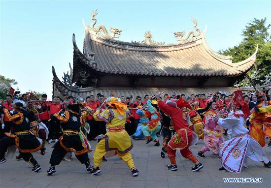 Mazu disciples from south China's Guangdong Province perform on a square at the Meizhou Island in Putian City, southeast China's Fujian Province, Oct. 25, 2020. In 2009, the Mazu belief and customs were inscribed on the UNESCO Representative List of the Intangible Cultural Heritage of Humanity. (Xinhua/Wei Peiquan)