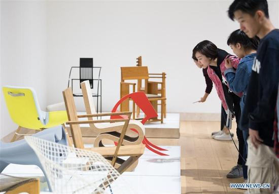 Visitors view a furniture exhibition at the China Design Museum in Hangzhou, east China's Zhejiang Province, April 8, 2018. Designed by Portuguese architect Alvaro Siza, the China Design Museum launched its first exhibitions when it was opened in Hangzhou on Sunday. With a floor area of 16,800 square meters, the museum is dedicated to the presentation and research of modern and contemporary designs while stimulating home-grown innovations. (Xinhua/Weng Xinyang)
