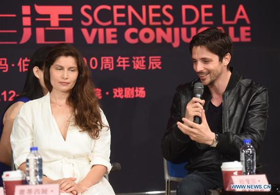 "Actress Laetitia Casta (L) and actor Raphael Personnaz attend a salon of the drama ""Scenes De La Vie Conjugale"" at the National Center for the Performing Arts in Beijing, capital of China, June 11, 2018. The drama is adapted from Ingmar Bergman's film with the same title. It will be staged on June 12 and 13 in Beijing. (Xinhua/Luo Xiaoguang)"