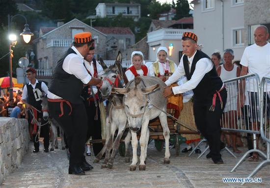 People prepare for the 51st traditional donkey races in Tribunj, Croatia, on Aug. 1, 2018. The event which dates back to 1950s features donkey-riders in traditional costumes racing around the village of Tribunj. (Xinhua/Dusko Jaramaz)