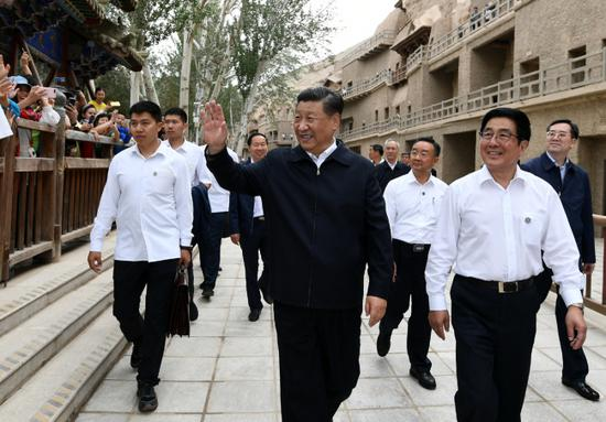 Xi Jinping, general secretary of the Communist Party of China Central Committee, visits the Mogao Grottoes in Dunhuang during his inspection tour of Gansu Province on August 19, 2019. [Photo: Xinhua/Xie Huanchi, Ju Peng]
