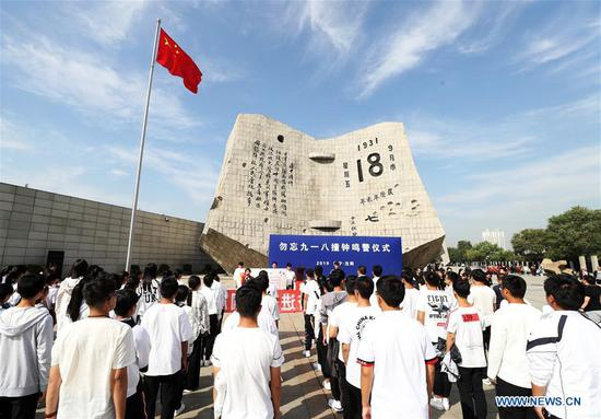 Students from Liaoning University hold an activity at the 9.18 Historical Museum in Shenyang, capital of northeast China's Liaoning Province, Sept. 17, 2019. Air raid sirens once again sounded through Shenyang at 9:18 a.m. on Wednesday, the 25th time the northeastern Chinese city in Liaoning Province commemorated the day with the alarm. This year marks the 88th anniversary of the