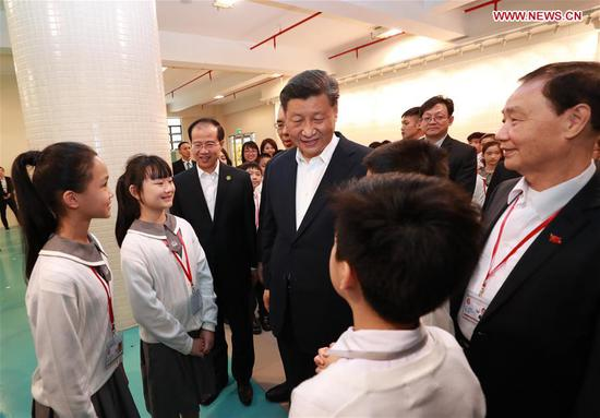 Chinese President Xi Jinping has exchanges with teachers and students at the Premier School Affiliated to Hou Kong Middle School, in south China's Macao, Dec. 19, 2019. (Xinhua/Pang Xinglei)