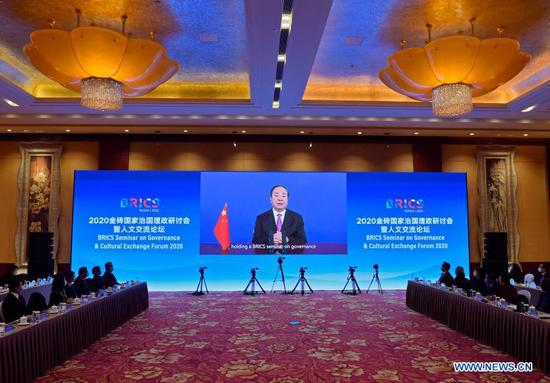 Huang Kunming, a member of the Political Bureau of the Communist Party of China (CPC) Central Committee and head of the Publicity Department of the CPC Central Committee, delivers a keynote speech at the opening ceremony of the 2020 BRICS governance seminar and cultural exchange forum via video link in Beijing, capital of China, Dec. 3, 2020. (Xinhua/Yue Yuewei)