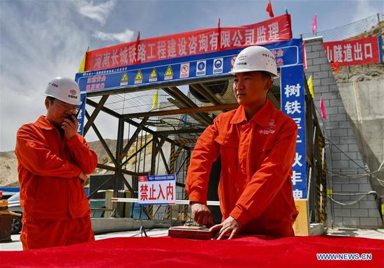 Workers detonate at the construction site of the Galashan Tunnel in Lhasa, southwest China's Tibet Autonomous Region, April 7, 2018. The 4,373-km-long tunnel, about 3,600 meters of altitude, is part of the Lhasa to Nyingchi railway. (Xinhua/Zhang Rufeng)