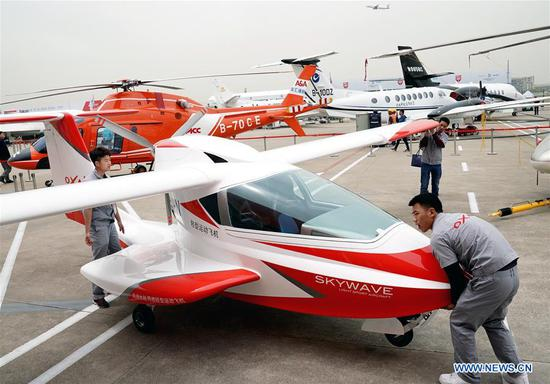 Exhibitors place aircrafts to be displayed in the Asian Business Aviation Conference and Exhibition (ABACE) at Shanghai Hongqiao International Airport in east China's Shanghai, April 16, 2018. The ABACE is expected to be held here from April 17 to 19, attracting over 170 companies around the world to participate in the exhibition. (Xinhua/Chen Fei)