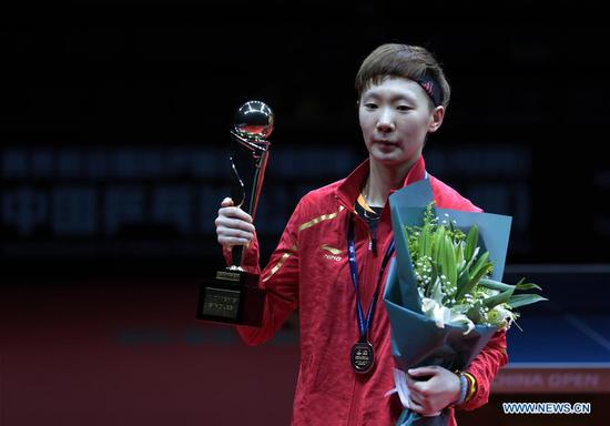 Wang Manyu of China poses with her trophy during the awardng ceremony for women's singles final match at the 2018 ITTF World tour China Open in Shenzhen, south China's Guangdong Province, on June 3, 2018. Wang Manyu claimed the title by defeating her teammate Ding Ning with 4-3 in the final. (Xinhua/Wang Dongzhen)
