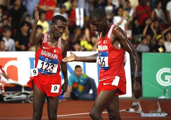 Birhanu Balew (L) of Bahrain celebrates with his teammate after men's 5000m final of athletics at the 18th Asian Games in Jakarta, Indonesia on Aug. 30, 2018. (Xinhua/Wang Lili)