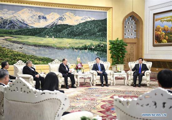Chinese Vice Premier Han Zheng (2nd R, back), also a member of the Standing Committee of the Political Bureau of the Communist Party of China (CPC) Central Committee, meets with a delegation led by Ho Iat Seng, president of the Macao Special Administrative Region (SAR)'s Legislative Assembly, at the Great Hall of the People in Beijing, capital of China, Oct. 10, 2018. (Xinhua/Yan Yan)