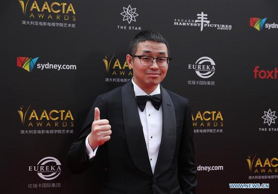 "Wen Muye, director of the Chinese film ""Dying to Survive"", poses for photos on the red carpet of the Australian Academy of Cinema and Television Arts (AACTA) awarding ceremony in Sydney, Australia, on Dec. 5, 2018. The 8th awards ceremony of AACTA was held here on Wednesday.  (Xinhua/Bai Xuefei)"
