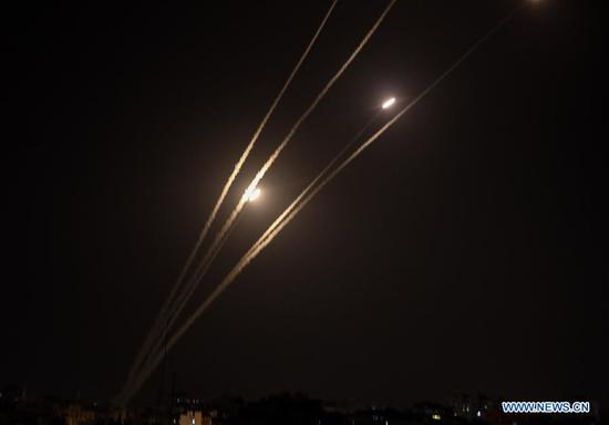 The picture taken from the Gaza Strip on May 4, 2019 shows missiles being launched toward Israel. Gaza militant groups fired rockets from the Gaza Strip into Israel on Saturday night, while Israeli warplanes continued striking on military facilities and posts that belong to militant groups. (Xinhua/Yasser Qudih)
