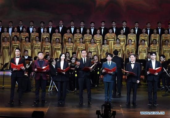 Actors perform during the launching ceremony of an event where selected TV series will be aired to celebrate the 70th anniversary of the founding of the People's Republic of China, in Qingdao, east China's Shandong Province, Aug. 25, 2019. (Xinhua/Li Ziheng)