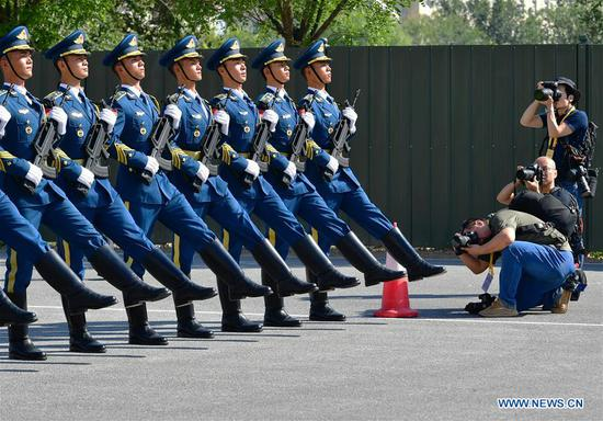 Journalists take photos during a visit to the National Day military parade training site in Beijing, capital of China, Sept. 25, 2019. A total of 47 journalists from home and abroad on Wednesday visited a training site of the military parade for the upcoming National Day celebrations. (Xinhua/Wei Peiquan)