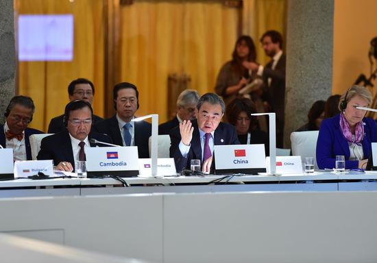 Chinese State Councilor and Foreign Minister Wang Yi addresses the 14th Foreign Ministers' Meeting of the Asia-Europe Meeting (ASEM) in Madrid, Spain, Dec. 16, 2019. (Xinhua/Lu Yang)