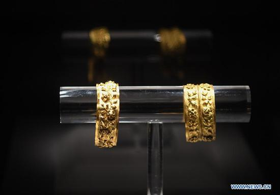 Pliers bracelets found on the wreckage of Nanhai No. 1 are displayed at the Maritime Silk Road Museum on Hailing Island of Yangjiang, south China's Guangdong Province, May 12, 2020. The excavation of the Nanhai No. 1, a shipwreck dating back to the Song Dynasty (960 A.D.-1279 A.D.), was listed by China in its top 10 archaeological discoveries for 2019. More than 180,000 relics including porcelain products, gold, silver, copper and iron relics and coins have been found from this ancient merchant ship. (Xinhua/Deng Hua)
