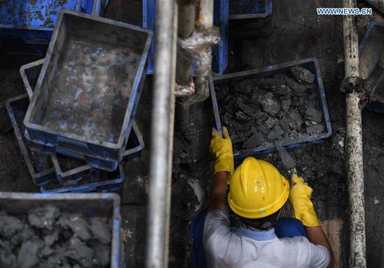 A staff member works at the excavation site of the shipwreck of Nanhai No. 1 in Yangjiang, south China's Guangdong Province, May 12, 2020. The excavation of the Nanhai No. 1, a shipwreck dating back to the Song Dynasty (960 A.D.-1279 A.D.), has entered the final stage and is expected to conclude in 2021, according to the excavation team. The excavation the ancient shipwreck was listed by China in its top 10 archaeological discoveries for 2019. (Xinhua/Deng Hua)