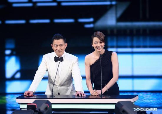 Actor Andy Lau (L) and actress Gigi Leung attend the 37th Hong Kong Film Awards presentation ceremony in Hong Kong, south China, April 15, 2018. (Xinhua/Qin Qing)