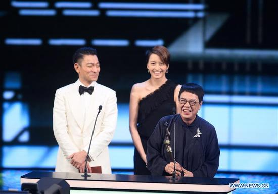 Director Ann Hui (front) poses during the 37th Hong Kong Film Awards presentation ceremony in Hong Kong, south China, April 15, 2018. Ann Hui won the Best Director for film