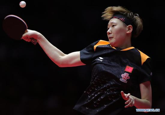 Wang Manyu of China returns the ball during the women's singles final match against Ding Ning of China at the 2018 ITTF World tour China Open in Shenzhen, south China's Guangdong Province, on June 3, 2018. Wang Manyu claimed the title by defeating Ding Ning with 4-3 in the final. (Xinhua/Wang Dongzhen)