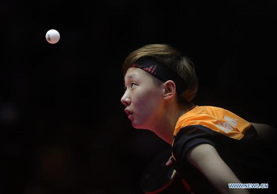 Wang Manyu of China serves during the women's singles final match against Ding Ning of China at the 2018 ITTF World tour China Open in Shenzhen, south China's Guangdong Province, on June 3, 2018. Wang Manyu claimed the title by defeating Ding Ning with 4-3 in the final. (Xinhua/Wang Dongzhen)